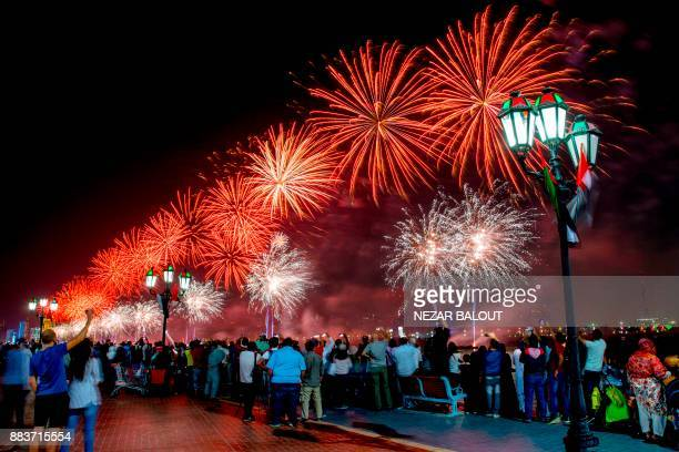 Fireworks illuminate the sky over the capital Abu Dhabi on December 1 during celebrations ahead of the 46th Emirati National Day celebrated on...