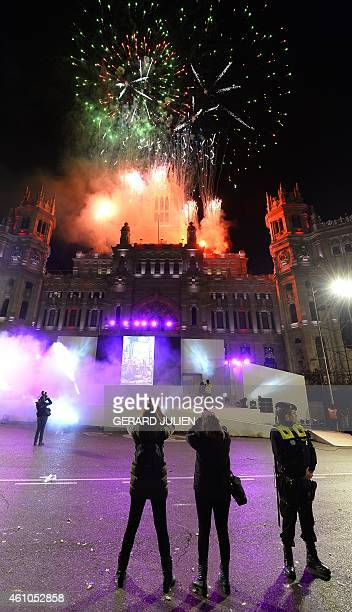 Fireworks illuminates the City Hall at Cibeles Square at the end of the Three Kings parade in Madrid on January 5 2015 Every year on January 5...