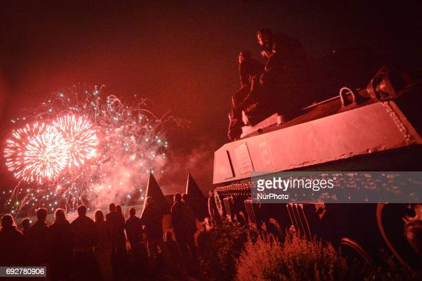 Fireworks in Arromanches-les-Bains seen from the M4A2 Sherman Tank Monument during D-Day Festival Normandy 2017. Tuesday 6th June is the 73rd...