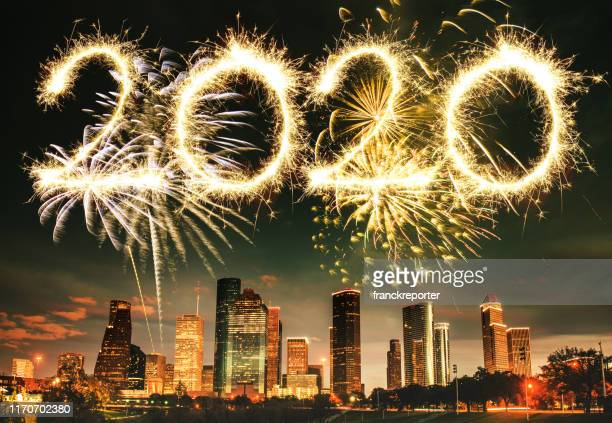 fireworks in houston skyline - texas - happy new year 2020 stock photos and pictures