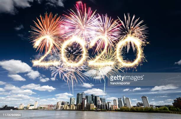 fireworks in london for 2020 new year in canary wharf - happy new year 2020 stock photos and pictures