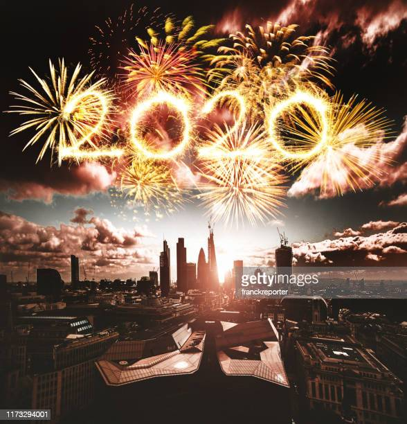 fireworks in london for 2020 new year - fireworks stock pictures, royalty-free photos & images