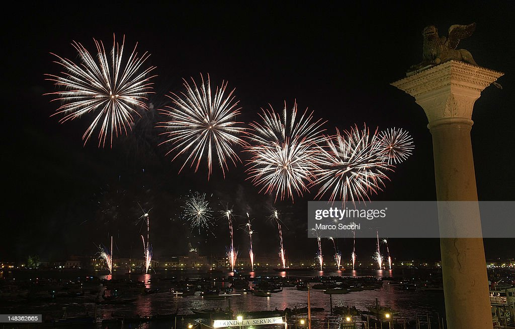 Fireworks in St Mark's basin at the end of the first day of Redentore celebrations on July 14, 2012 in Venice, Italy. Redentore is one of the most loved celebrations by Venetians which is in remembrance for the end of the 1577 plague. Highlights of the celebration include the pontoon bridge extending across the Giudecca Canal, gatherings on boats in the St Mark's basin and a spectacular fireworks display.
