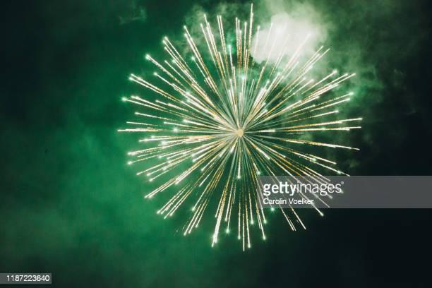 fireworks in the black sky during the light show at the cathedral - fireworks stock pictures, royalty-free photos & images
