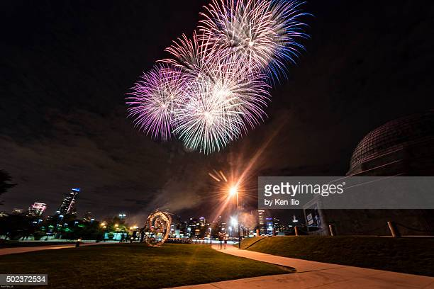 fireworks in the city - ken ilio stock pictures, royalty-free photos & images