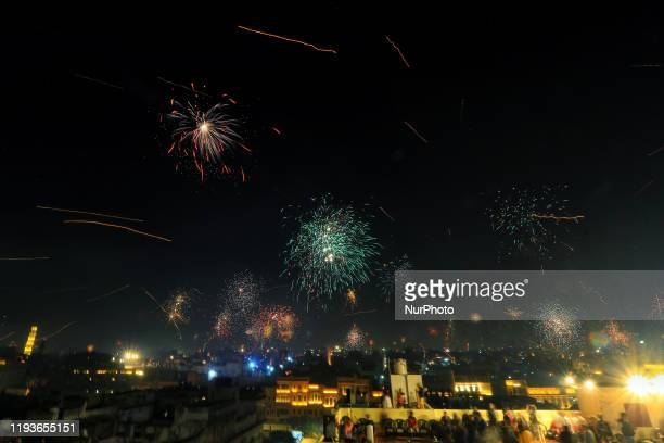 Fireworks in the walled city area on the occasion of the Makar Sakranti Festival in Jaipur Rajasthan India Jan 14 2020