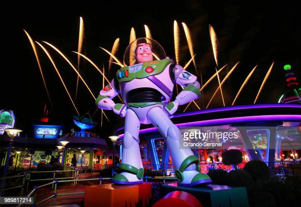 Fireworks launch behind a giant statue of the Buzz Lightyear character at the new Toy Story Land at Disney's Hollywood Studios on Thursday June 28...