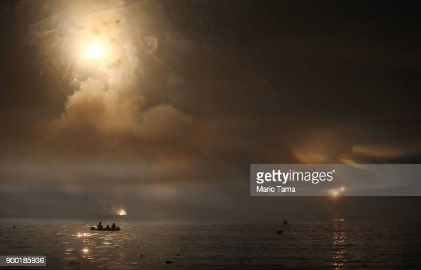 Fireworks launched from barges explode and light the waters along Copacabana beach on January 1 2018 in Rio de Janeiro Brazil Fireworks were launched...