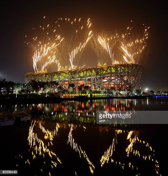 Fireworks light the night sky above the National Stadium or 'Birds Nest' during the closing ceremony of the 2008 Beijing Olympic Games in Beijing on...