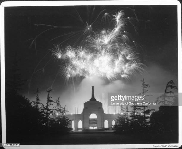 Fireworks light the night sky over the Coliseum Los Angeles California early to mid twentieth century