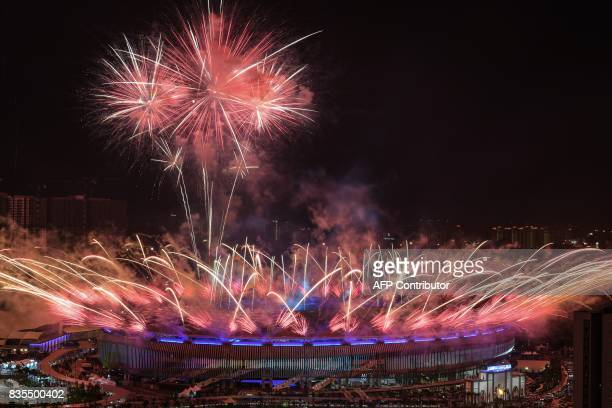 Fireworks light the sky above the Bukit Jalil National Stadium during the opening ceremony of the 29th Southeast Asian Games in Kuala Lumpur on...