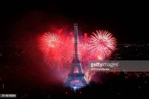 TOPSHOT Fireworks light the sky above the Eiffel Tower in the French capital Paris on July 14 2017 as part of France's annual Bastille Day...