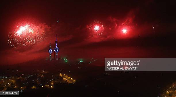 Fireworks light the sky around Kuwait's landmark towers during celebrations marking the 55th anniversary of the Gulf emirate's independence and the...
