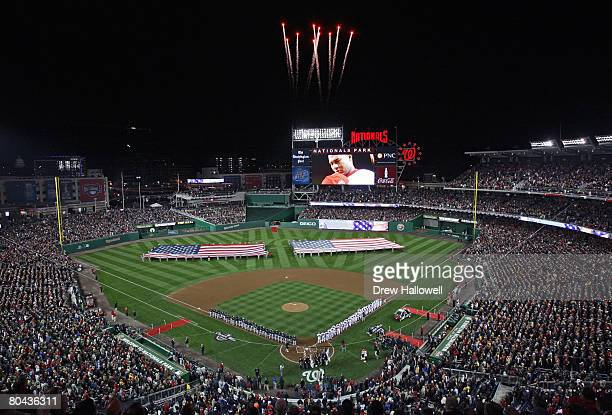 Fireworks light the sky during the national anthem before the game between the Washington Nationals and Atlanta Braves on opening day March 30, 2008...