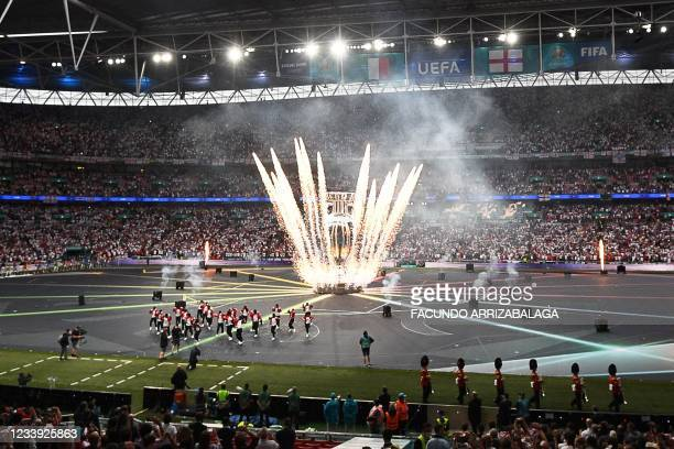 Fireworks light the sky during the opening ceremony of the UEFA EURO 2020 final football match between Italy and England at the Wembley Stadium in...