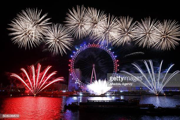 Fireworks light the sky near 'London Eye' during New Year's celebrations in London England on January 01 2016