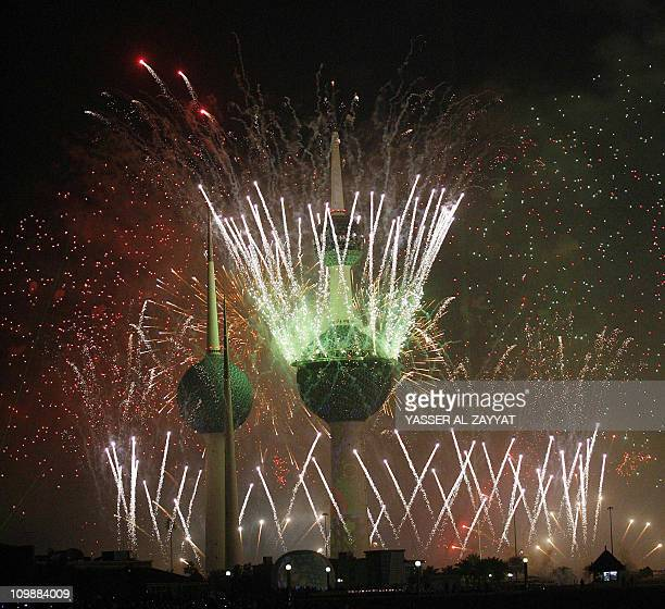 Fireworks light the sky near the Kuwait Towers in Kuwait City on February 25 2011 during celebrations marking the Gulf state's 50th Independence Day...
