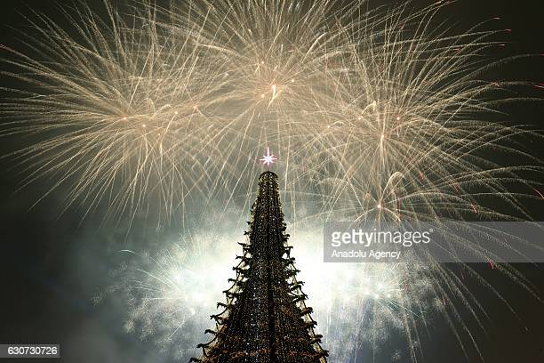 Fireworks light up near the main Christmas tree at the Republic Square during the New Year's Eve celebrations in Yerevan Armenia on December 31 2016