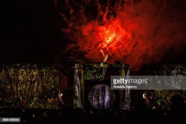 Fireworks light up sky during preparations for the Christmas celebrations at the Bolivar Square in Bogota Colombia on December 20 2017 Colombian...