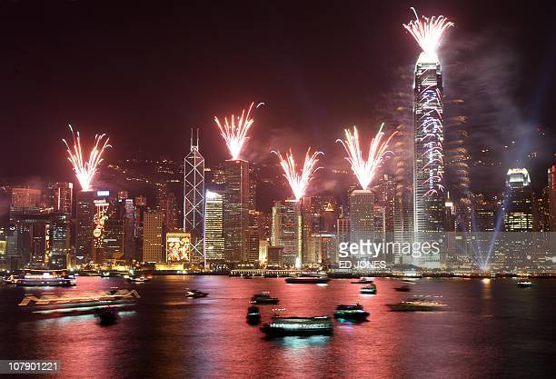 Fireworks light up the Hong Kong skyline above Victoria harbour on January 1 2011 Around 400000 were expected to attend the display marking the new...