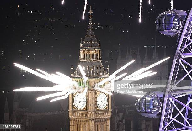 Fireworks light up the London skyline and Big Ben just after midnight on January 1 2012 in London England Thousands of people lined the banks of the...