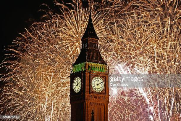 Fireworks light up the London skyline and Big Ben just after midnight on January 1 2014 in London England Thousands of people lined the banks of the...