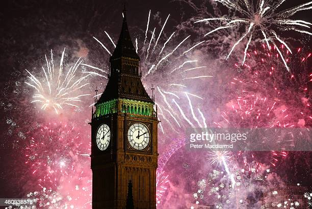 Fireworks light up the London skyline and Big Ben just after midnight on January 1 2015 in London England For the first time thousands of people have...