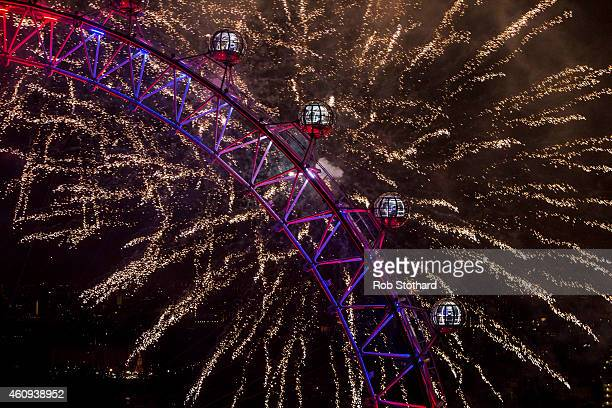 Fireworks light up the London skyline and Big Ben just after midnight on January 1 2015 in London England Thousands of people lined the banks of the...