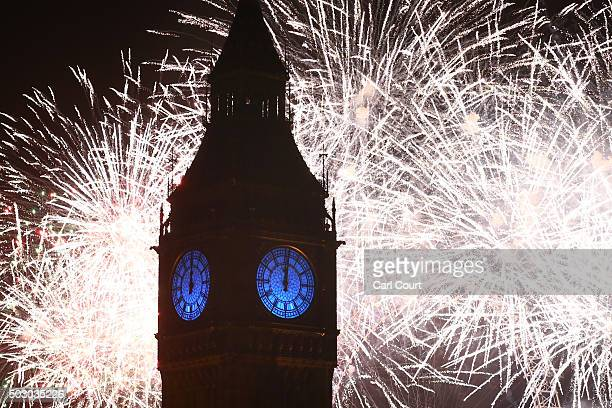 Fireworks light up the London skyline and Big Ben just after midnight on January 01 2016 in London England Thousands of people have bought tickets to...