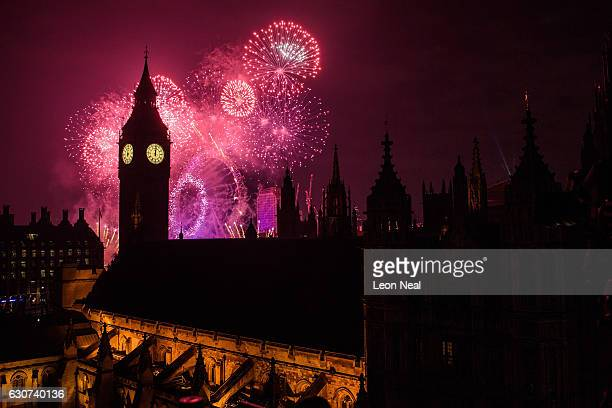 Fireworks light up the London skyline and Big Ben just after midnight on January 1 2017 in London England Thousands of people lined the banks of the...