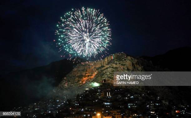 Fireworks light up the mountain in the Kurdish town of Akra 500 kilometres north of Baghdad on March 20 2018 during celebrations for Noruz the...