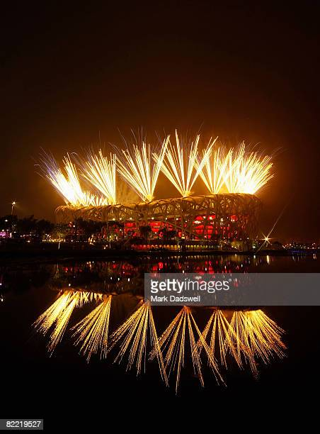 Fireworks light up the National Stadium during the Opening Ceremony for the 2008 Beijing Summer Olympics at the Pond Bridge on August 8, 2008 in...