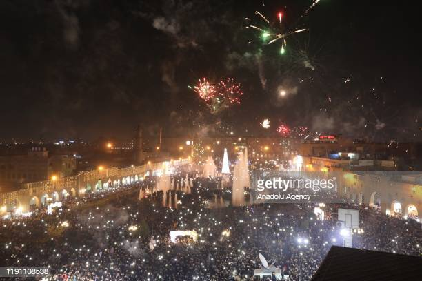 Fireworks light up the night sky over Erbil Citadel during the new year celebrations in Erbil Iraq on January 01 2020