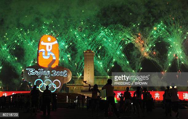 Fireworks light up the night sky over Tiananmen Square moments after the end of the opening ceremony to start the 2008 Beijing Olympic Games in...