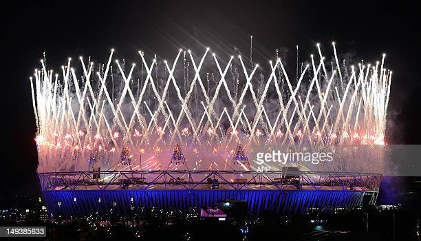 Fireworks light up the Olympic Stadium during the opening ceremony of the London 2012 Olympic Games in London on July 28 2012 AFP PHOTO/Indranil...