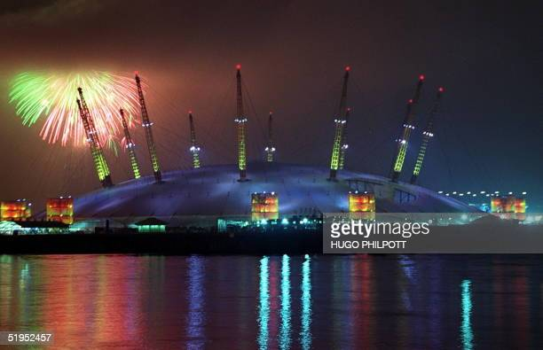 Fireworks light up the sky 01January 2000 on the strike of midnight as low cloud threatens to engulf Britain's flagship millennium dome The midnight...