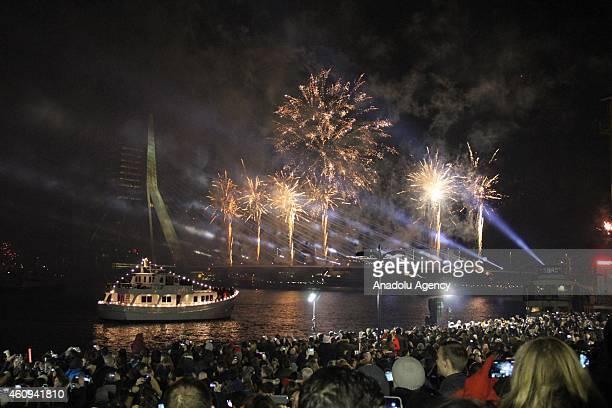Fireworks light up the sky above the Erasmus Bridge in Rotterdam Netherlands on January 01 2015