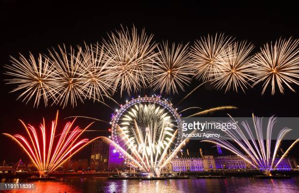 Fireworks light up the sky above the London Eye during the new year celebrations in London, United Kingdom on January 01, 2020.