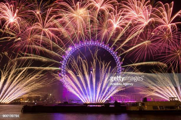 Fireworks light up the sky above the London Eye during the new year celebrations in London, United Kingdom on January 01, 2018.