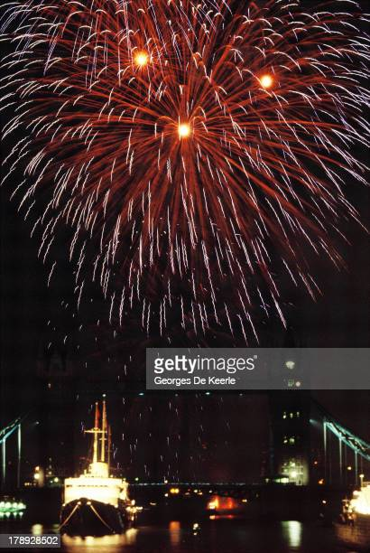 Fireworks light up the sky above Tower Bridge to celebrate the Queen Mother's 90th Birthday on August 4 1990 in London England