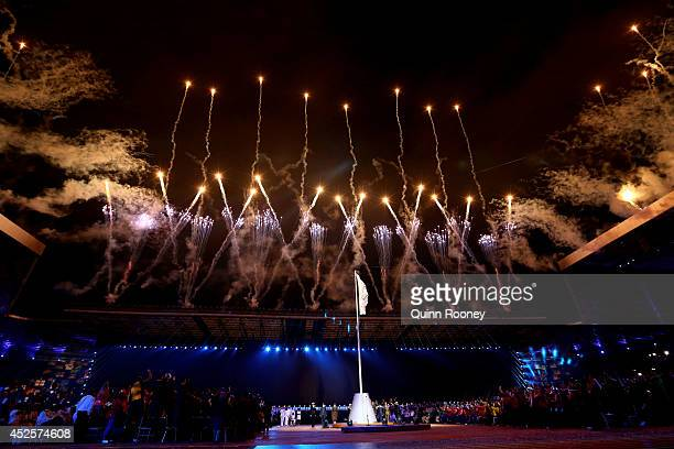 Fireworks light up the sky as the Commonwealth flag is raised during the Opening Ceremony for the Glasgow 2014 Commonwealth Games at Celtic Park on...