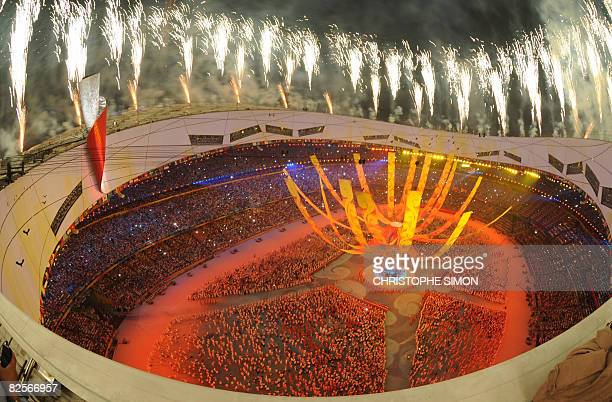 Fireworks light up the sky at the end of the closing and handover ceremony for the 2008 Beijing Olympic Games at the National Stadium also know as...