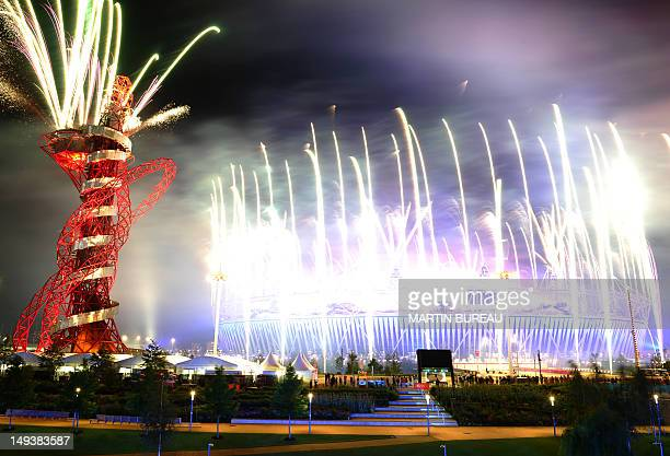 Fireworks light up the sky at The Olympic Stadium in London on July 28 during the opening ceremony of The 2012 London Olympic Games AFP PHOTO /...