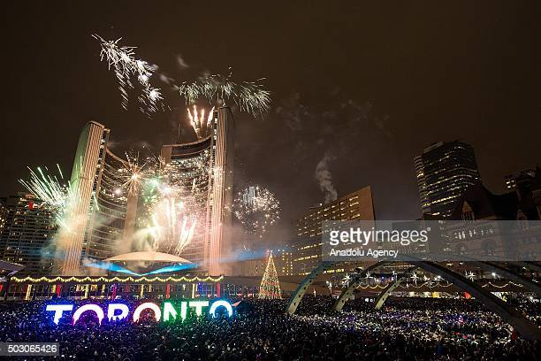 Fireworks light up the sky at Toronto's City Hall Nathan Phillips Square as the clock strikes midnight on January 1 2016