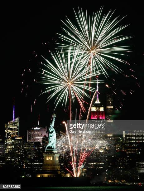 Fireworks light up the sky between the Statue of Liberty and Empire State in New York City in a show sponsored by Briggs Inc on June 27 2017 as seen...