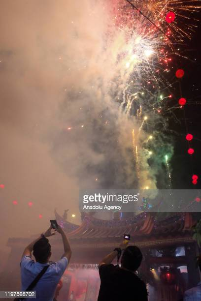 Fireworks light up the sky during 6th days Chinese New Year celebrations or known as Cue Lak in Selatpanjang Meranti Island Regency Riau Province...