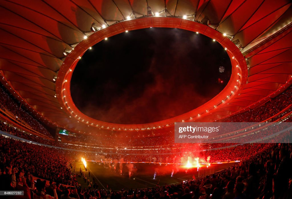 TOPSHOT - Fireworks light up the sky during the inauguration of the Wanda Metropolitano stadium after the Spanish league football match Club Atletico de Madrid vs Malaga CF in Madrid on September 16, 2017. /