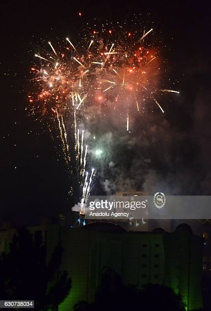 Fireworks light up the sky during the new year celebrations at Kampala, Uganda on January 01, 2017.