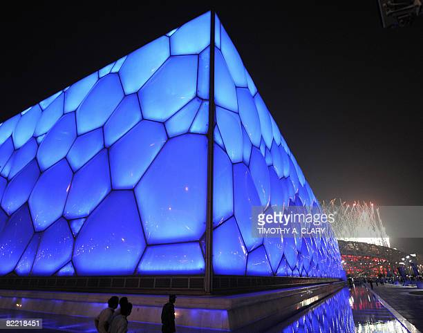 Fireworks light up the sky during the opening ceremony for the 2008 Beijing Olympic Games outside the National Aquatics Center and the National...