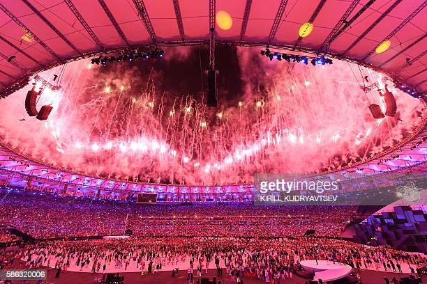 Fireworks light up the sky during the opening ceremony of the Rio 2016 Olympic Games at Maracana Stadium in Rio de Janeiro on August 5, 2016. / AFP /...